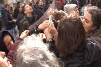 Taksim'deki protestoda kafasına binadan kopan tahta düştü