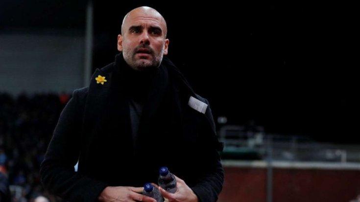 Tutuklu Katalan liderlere destek için maçlarda yakasına sarı kurdele takan Manchester City Teknik Direktörüne her hafta 20 bin pound ceza kesiliyor