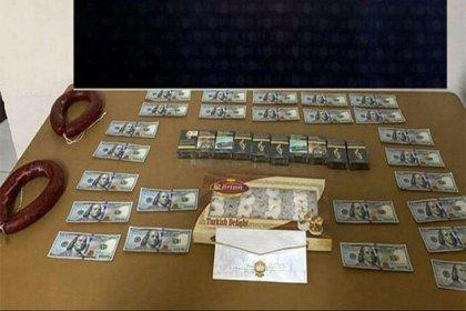 Rüşvet olarak 2 kangal sucuk, bir kutu lokum, 10 paket sigara ve 2 bin 500 dolar isteyen memur suç üstü yakalandı